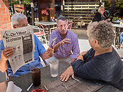 23 SEPTEMBER 2019 - DES MOINES, IOWA: MARK SANFORD, center, the former Republican Governor of South Carolina and six term Congressman from South Carolina, talks to people at Zombie Burger, a Des Moines restaurant, Monday. Sanford is challenging incumbent President Donald Trump for the Republican nomination for the US presidency. Iowa hosts the first event of the presidential selection cycle. The Iowa Caucuses are scheduled for February 3, 2020.           PHOTO BY JACK KURTZ