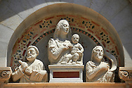 Medieval Sculptures of The Madonna & Child above the door to the The Leaning Tower Of Pisa, Italy