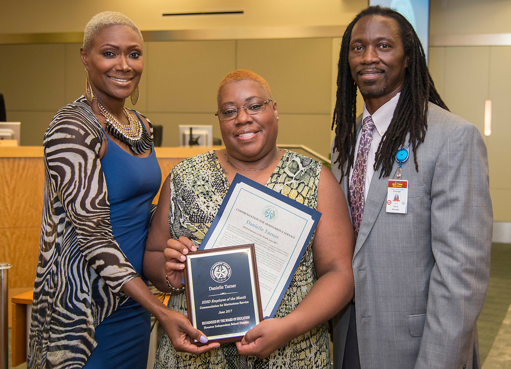 Houston ISD Trustee Jolanda Jones poses for a photograph with Employee of the Month Danielle Turner and Kenneth Davis during a Houston ISD Board of Trustee meeting, May 11, 2017.