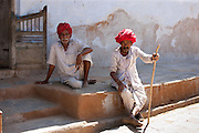 Indian men wearing traditional clothing and Rajasthani turbans in village of Nimaj, Rajasthan, Northern India