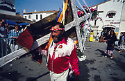 Europe, France, Camargue, Saintes Maries de la Mer, Gypsy Pilgrimmage 'Pelerinage des Gitans aux Saintes Maries de la Mer'. The celebrated Manouche Pépé Lafleur carries the Gypsy Standard to the church in the morning of the procession. Gypsies from all over the world come to celebrate their patron Saint Sara who is carried by them from the church to the sea-shore. May 24th and 25th every year.