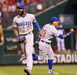 September 27, 2017 - St. Louis, MO, USA - Chicago Cubs right fielder Jason Heyward, left, and second baseman Javier Baez react after Heyward caught a fly ball by the St. Louis Cardinals' Dexter Fowler with the bases loaded to end the eighth inning on Wednesday, Sept. 27, 2017, at Busch Stadium in St. Louis. The Cubs clinched the N.L. Central Division title with a 5-1 victory. (Credit Image: © Chris Lee/TNS via ZUMA Wire)