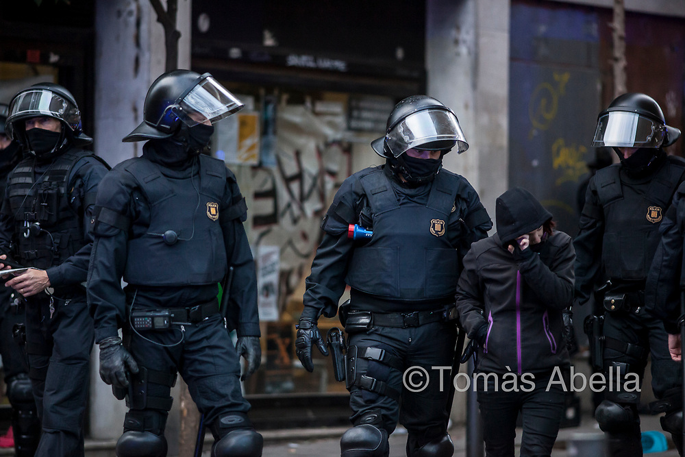 """An activist defending the squatted social centre (CSO) """"Banc Expropiat"""" is evicted and arrested by police. The building was originally owned by a bank rescued by public funds in 2012, and subsequently sold to a property speculator."""
