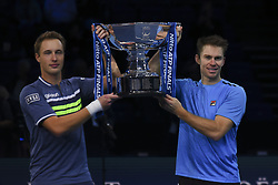 November 19, 2017 - London, England, United Kingdom - Henri Kontinen of Finland and John Peers of Australia lift the trophy following victory following the doubles final against Marcelo Melo of Brazil nd Lukasz Kubot of Poland during day eight of the 2017 Nitto ATP World Tour Finals at O2 Arena on November 19, 2017 in London, England. (Credit Image: © Alberto Pezzali/NurPhoto via ZUMA Press)