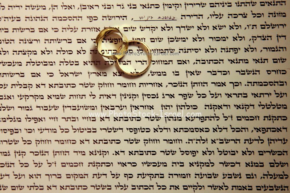Jewish wedding ceremony The ketubah (prenuptial agreement) and wedding rings