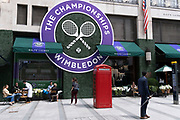 The logo for the Lawn Tennis Association's (LTA) Wimbledon tennis championship appears large on the exterior facade of style retailer, Ralph Lauren in Bond Street, on 8th July 2021, in London, England.