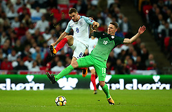 Jordan Henderson of England challenges Rajko Rotman of Slovenia - Mandatory by-line: Robbie Stephenson/JMP - 05/10/2017 - FOOTBALL - Wembley Stadium - London, United Kingdom - England v Slovenia - World Cup qualifier