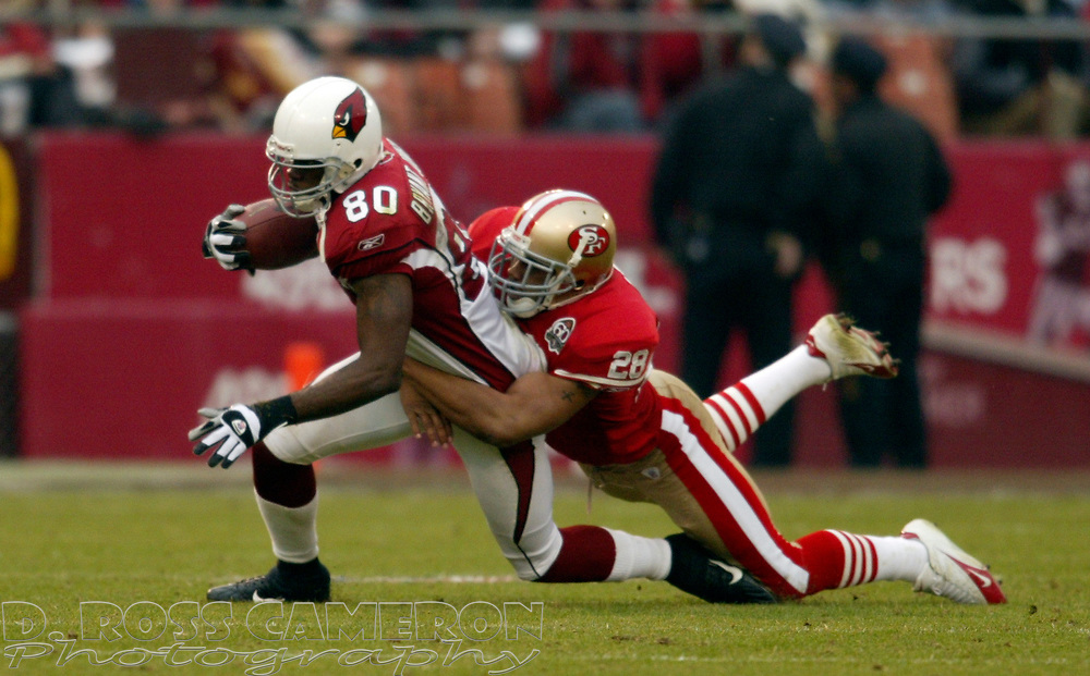 San Francisco 49ers cornerback Keith Lewis (28) drags down Arizona Cardinals wide receiver Bryant Johnson during the third quarter of an NFL football game, Sunday, Dec. 24, 2006 at Candlestick Park in San Francisco. The Cardinals won, 26-20. (D. Ross Cameron/The Oakland Tribune)