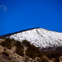 The moon rises over the summit of Mount Taylor inGrants Wednesday.