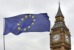 """File photo dated 29/03/17 of an EU flag flying in front of the Houses of Parliament in London. Theresa May is facing another parliamentary bust-up over her flagship Brexit legislation after a compromise designed to keep critics in her own party on board was denounced as """"unacceptable"""" by Tory Remainers."""