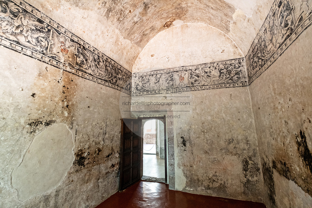 A friars chamber with murals in the San Nicolas Tolentino Temple and Ex-Monastery in Actopan, Hidalgo, Mexico. The colonial church and convent  was built in 1546 and combine architectural elements from the romantic, gothic and renaissance periods.