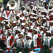 Members of the the FAMU Marching 100 band sing in their seats during the Florida Classic NCAA football game between the FAMU Rattlers and the Bethune Cookman Wildcats at the Florida Citrus bowl on Saturday, November 22, 2014 in Orlando, Florida. (AP Photo/Alex Menendez)