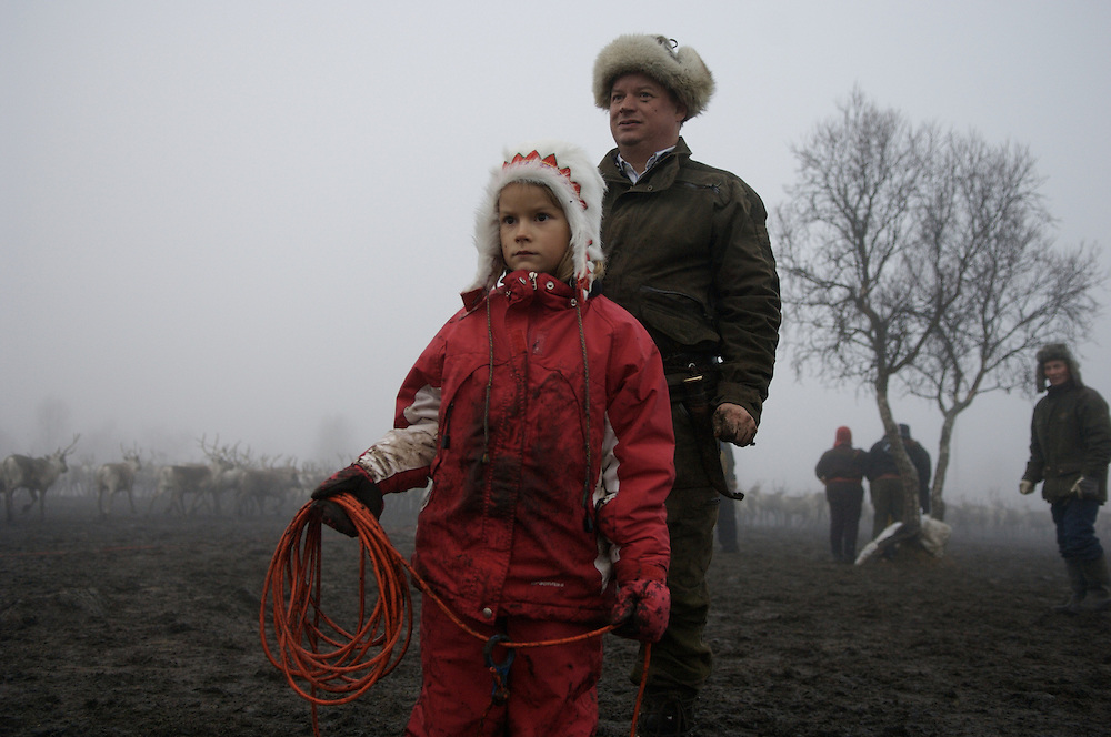 (selected for The National Portrait Gallery's Photographic Portrait Prize, exhibiting from November 4, 2008- February 15, 2009) Hirvas Salmi, FINLAND. October 15, 2007- A father and his 7 year old daughter scan the galloping reindeer in search of their calves. The Sami herding lifestyle struggles to maintain its force in numbers with lower wages and a demanding work schedule. Very few youth seek a future as a full time herder.