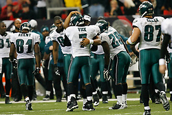 Philadelphia Eagles quarterback Michael Vick #7 embraces quarterback Donovan McNabb #5 after Vick threw a pass for a touchdown during the NFL game between the Philadelphia Eagles and the Atlanta Falcons on December 6th 2009. The Eagles won 34-7 at The Georgia Dome in Atlanta, Georgia. (Photo By Brian Garfinkel)