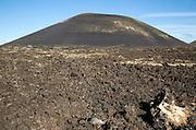 Malpais badlands volcanic landscape Montana Negra volcano cone, Parque Natural Los Volcanes, Lanzarote, Canary islands, Spain