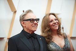 Harvey Keitel and Daphna Kastner arrive on the red carpet of The 92nd Oscars® at the Dolby® Theatre in Hollywood, CA on Sunday, February 9, 2020.