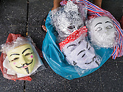 """09 JUNE 2013 - BANGKOK, THAILAND:  Guy Fawkes masks for in front of Central World Mall before an anti-government protest. The White Mask protesters wear the Guy Fawkes mask popularized by the movie """"V for Vendetta"""" and the protest groups Anonymous and Occupy. Several hundred members of the White Mask movement gathered on the plaza in front of Central World, a large shopping complex at the Ratchaprasong Intersection in Bangkok, to protest against the government of Thai Prime Minister Yingluck Shinawatra. They say that her government is corrupt and is a """"puppet"""" of ousted (and exiled) former PM Thaksin Shinawatra. Thaksin is Yingluck's brother. She was elected in 2011 when her brother endorsed her.    PHOTO BY JACK KURTZ"""