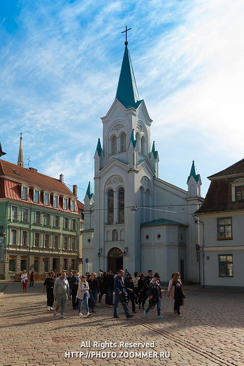 Tourist group near Our Lady of Sorrows Church, Riga, Latvia