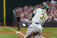 Oakland Athletics left fielder Jonny Gomes connects for a grand slam against the Minnesota Twins on July 13, 2012 at Target Field in Minneapolis, Minnesota.  The Athletics defeated the Twins 6 to 3.  © 2012 Ben Krause