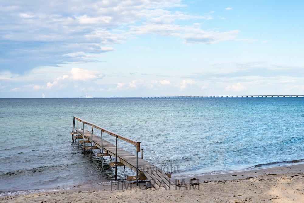 Jetty and emptiness with Storebaelt Bridge behind at Nyborg on Funen Island, Denmark