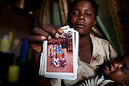 Mama Bhoke holds a photogrpah of her late husbend Mohono Marwa (Right) in Kigonga, Tanzania, on Friday, July 30, 2010. Photographer: Trevor Snapp