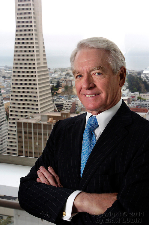 Charles Schwab, founder of the Charles Schwab Corporation, stands near a window overlooking the Trans America building while visiting the Bloomberg office in downtown San Francisco, Calif., on Friday, May 11, 2007. ..PHOTOGRAPHER: Erin Lubin/Bloomberg News.