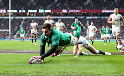 Ireland's Jacob Stockdale scores his side's third try during the NatWest 6 Nations match at Twickenham Stadium, London.