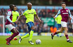 Derby County's Andre Wisdom attacks Aston Villa's Albert Adomah and Aston Villa's Jack Grealish