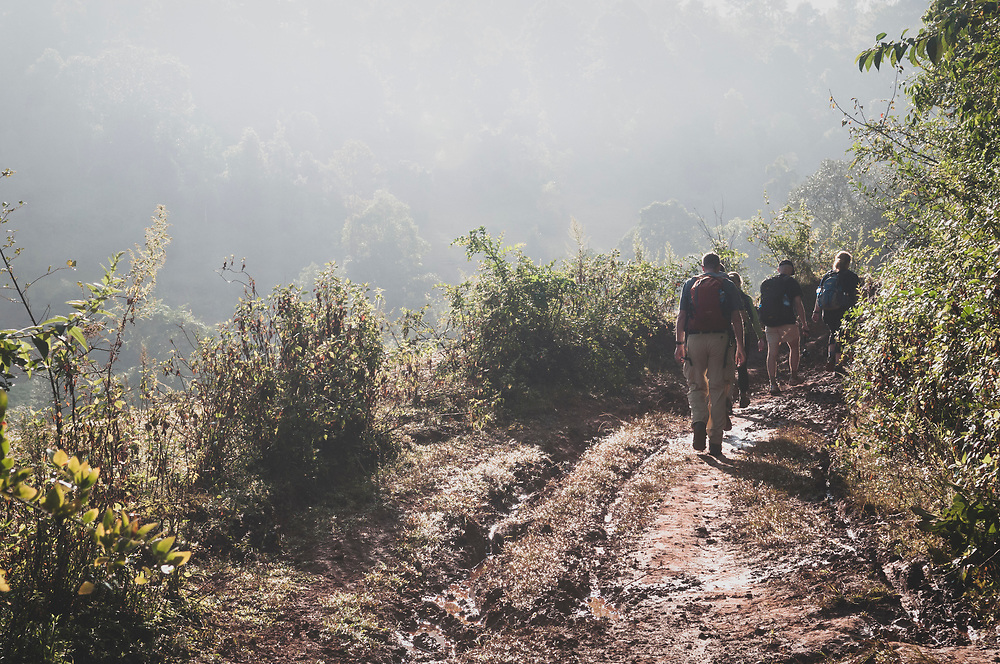 Kalaw, Myanmar - November 3, 2011: Tourists from several European countries do a three-day trek from Kalaw to Inle Lake in Shan State, Myanmar