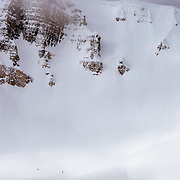 Unidentifed skiers making their way down Cody Peak in the Teton backcountry.