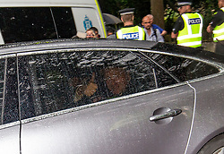 Boris Johnson leaving from the rear of Bute House after meeting Nicola Sturgeon.