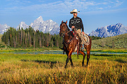 A wrangler at the edge of a small pond in Grand Teton National Park in Jackson Hole, WY.
