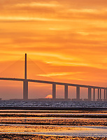 Sun rising under the Sunshine Skyway bridge from Fort De Soto Park. Print copy 4 of 5 images taken with a Fuji X-H1 camera and 200 mm f/2 OIS lens with a 1.4x teleconverter (ISO 400, 280 mm, f/16, 1/80 sec). Raw images processed with Capture One Pro and AutoPano Giga Pro.