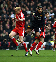 Photo: Mark Stephenson/Sportsbeat Images.<br /> Liverpool v Manchester United. The FA Barclays Premiership. 16/12/2007.Liverpool's John Arne Riise (L) and Carlos Tevez clash