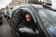 Licensed taxi drivers block the traffic in Parliament Square between 1pm-4pm in protest against traffic policies, 11th of February 2019, Central London, United Kingdom..  A taxi driver sits in her parked up taxi outside Parliament.  The disgruntled taxi drivers feel squeezed by local government transport policies. They say they will continue their protest and blockade the square every other day the same time until they feel the Mayor of London listens to them.