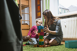 Mother playing with her son with toy building blocks, Munich, Germany
