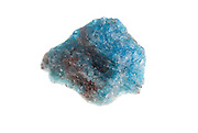 Cutout of a blue apatite gemstone on white background