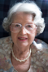 Portrait of an older lady in the communal lounge of a warden aided home,