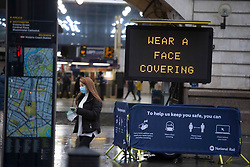 © Licensed to London News Pictures.13/12/2020. London, UK. A commuter in mask arrives in London Victoria Station. Health Secretary Matt Hancock says infections are starting to rise in some areas after falling during a four-week national lockdown in England that ended Dec. 2. Photo credit: Marcin Nowak/LNP