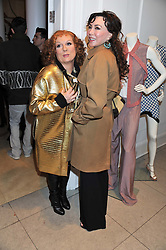 Left to right, JENNIFER SAUNDERS as her TV character Edina Monsoon and MARIE HELVIN at a party to celebrate the switching on of the Christmas Lights at the Stella McCartney store, Bruton Street, London on 29th November 2011.