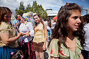 Girls are being offered from 13 years. Each spring in Mogila, Bulgaria, is celebrated the Gypsy Bride Market. In this festival the virginity is for sale. The honor can be bought. Every girl has a price to be agreed between the parents of the girl and the candidate. The price can range between 1.500 and 10.000€, in a country where the minimum salary is just over 100€. The market joins the Kalajdzii families, known as the thracians tinkerers, whose tradition is still alive. Many girls dress as real princesses, others prefer to dress in a modern way. They dance during hours the ring dance while grandparents and parents watch the way the young interrelate. Many girls dream to be married by the rite imposed by the tradition. Nowadays there are some girls that don't agree with the tradition and would prefer not to marry, although they assist to these market all the times. Divorces and elopements, so far taboo, are becoming everytime more frequent. Beyond the topic, ethnologists, define it as the Kalajdzii's disco, where the family honor is involved in a commercial transaction. This ritual has being celebrated for years, so anthropologists think is not going to change too much in future.