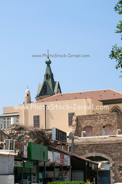 The top of the Jaffa clock tower as seen over the rooftops of the neighbouring buildings