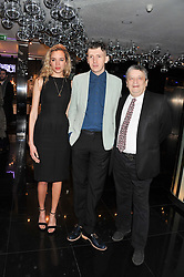 Left to right, PHOEBE COLLINGS JAMES, MATTHEW STONE and SIR NORMAN ROSENTHAL at W London - Leicester Square for the Liberatum Cultural Honour in Spice Market for John Hurt, CBE in association with artist Svetlana K-Lié on 10th April 2013.