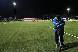 20 February 2017 - The FA Cup - (5th Round) - Sutton United v Arsenal - A dejected Paul Doswell manager of Sutton United embraces a ball boy after the match - Photo: Marc Atkins / Offside.
