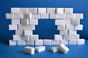Composition of sugar cubes in the shape of a brick wall.