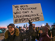 17 DECEMBER 2019 - DES MOINES, IOWA: BRITTON GRIM, from Des Moines, holds a sign calling for the impeachment of President Donald Trump in front of the Iowa State Capitol. About 300 people came to the Iowa State Capitol in Des Moines in near freezing weather Tuesday evening to call for Trump's impeachment. The rally, and others like it around the US, come on the eve of an impeachment vote in the US House of Representatives.    PHOTO BY JACK KURTZ
