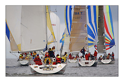 Yachting- The first days inshore racing  of the Bell Lawrie Scottish series 2003 at Tarbert Loch Fyne.  Light shifty winds dominated the racing...Loony Tunes as the class 2 and 3 fleets head downwind...Pics Marc Turner / PFM