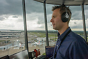 NATS Heathrow air traffic controller in control tower at Heathrow airport, London. <br /> <br /> From the chapter entitled 'Up in the Air' and from the book 'Risk Wise: Nine Everyday Adventures' by Polly Morland (Allianz, The School of Life, Profile Books, 2015).