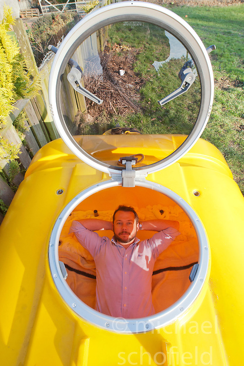 Nick Hancock inside his survival pod. He will head for Rockall in the Atlantic, and the adventurer is planning to spend two months on Britain's most remote outpost, and he is building his survival pod in his back garden..© Michael Schofield...