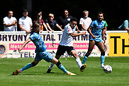 Ben Stevenson (7) of Forest Green Rovers battles for possession during the Pre-Season Friendly match between Yate Town and Forest Green Rovers at the Jelf Stadium, Yate, United Kingdom on 17 July 2021.